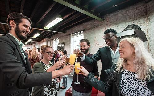 rg-employees-celebrating-reward-and-recognition-cheers