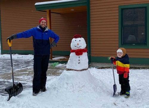 JB building a snowman with son