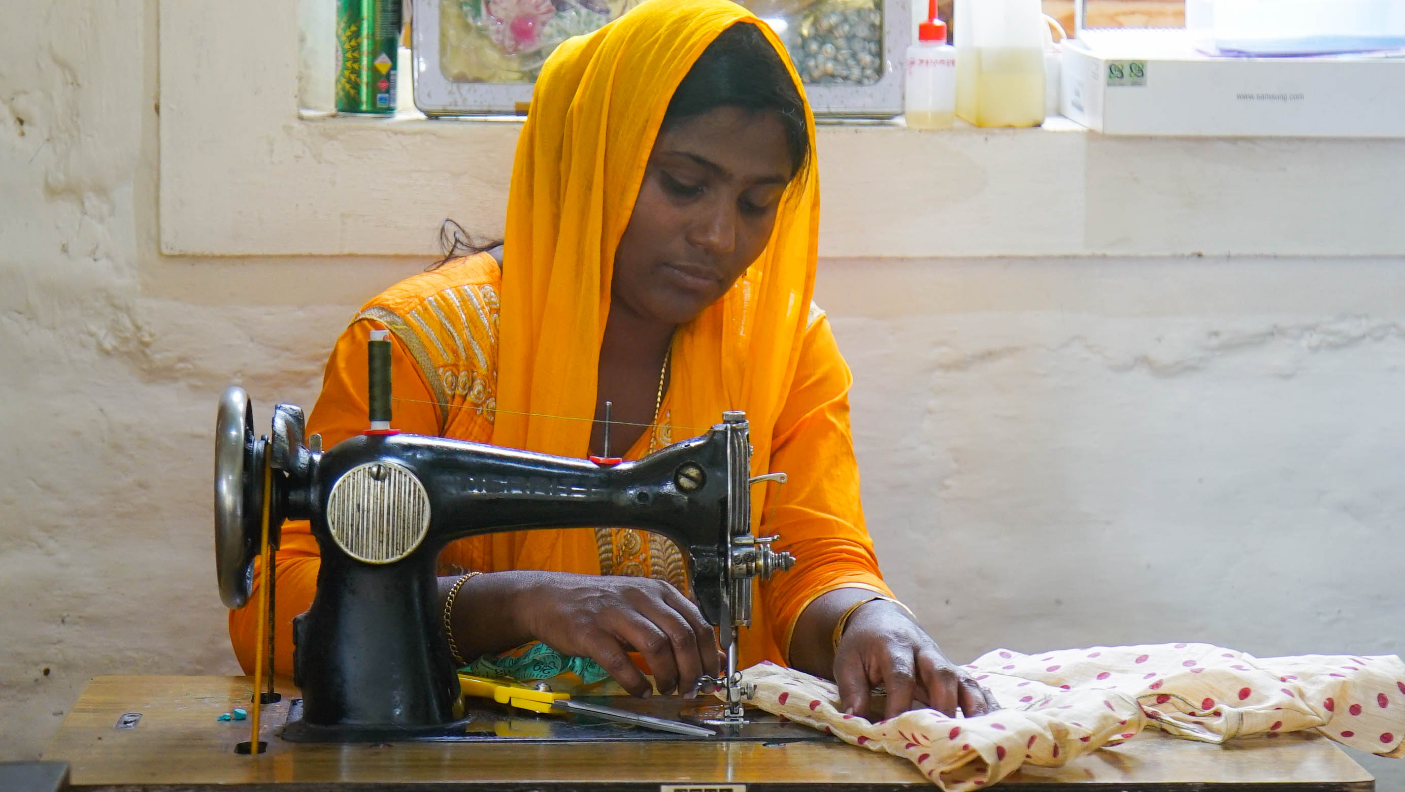 Students learning stiching skills at sewing centre.jpg