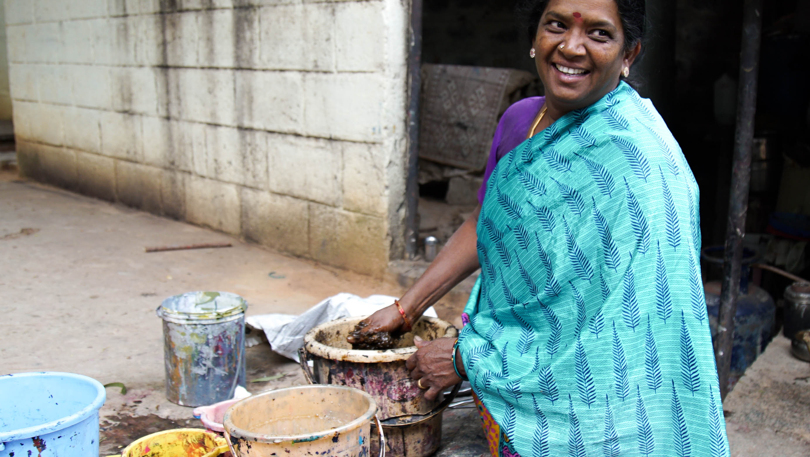 Tharangini mixing dyes for fabric.jpg